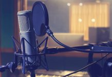 A picture depicting a microphone with pop screen in a home recording studio