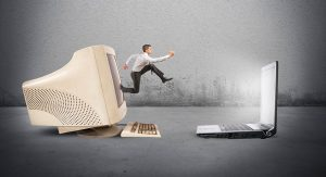 Updating outdated voice overs. A man jumps from an old computer into a new one.