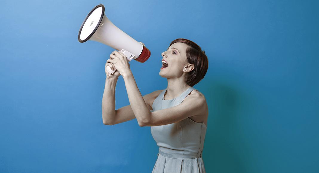 A woman using a bullhorn