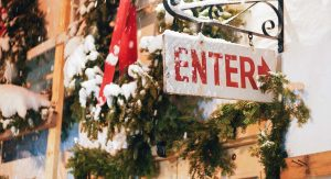 anEnter sign covered in snow during the holiday season.