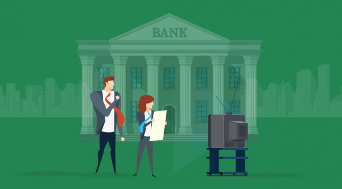 Animated image of two employees standing in front of a bank, watching a TV.
