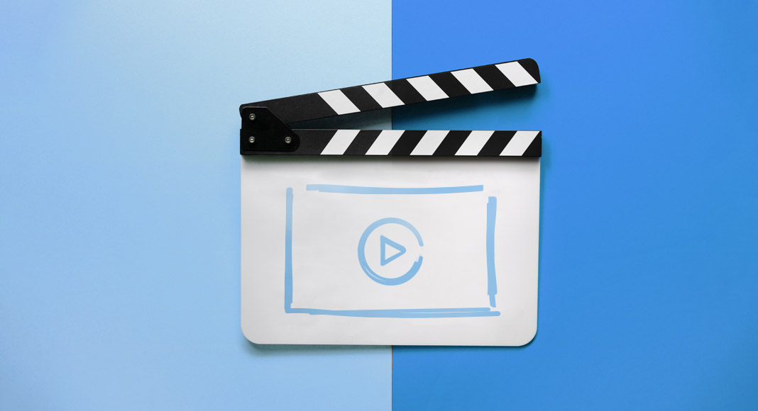 Explainer video clapper against a blue background