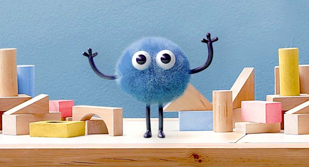A cartoon blue dude holds his arms up