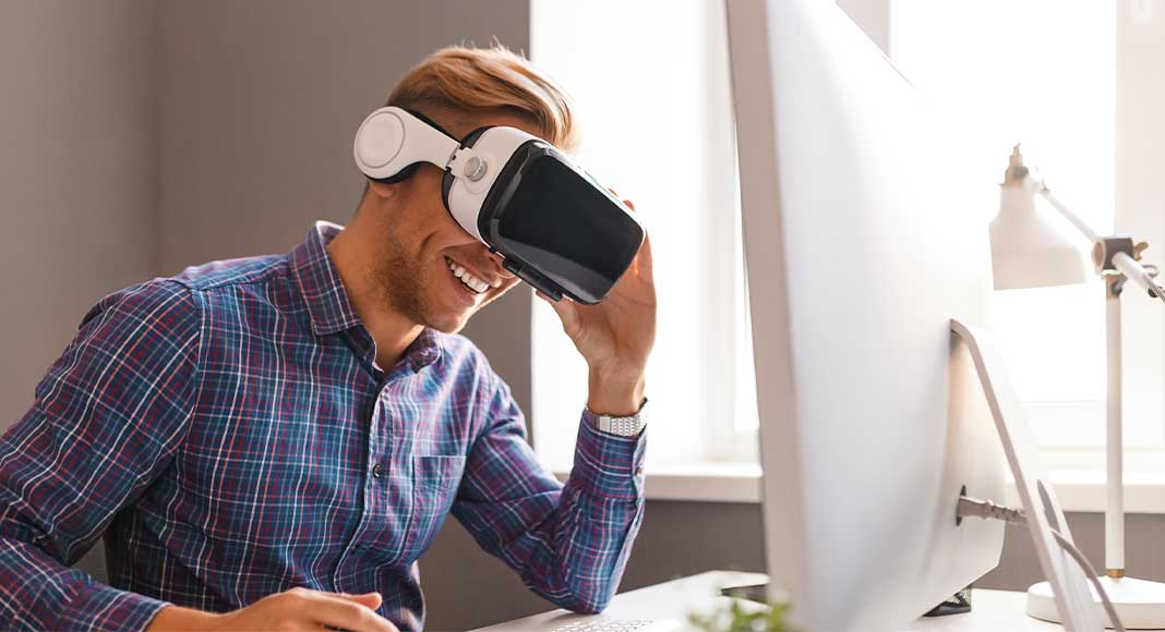 Blond-haired man wearing virtual reality headset