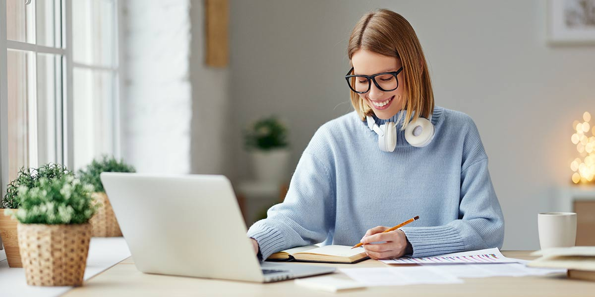 Freelancer working from home on a laptop and communicating with clients