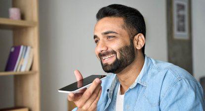 Bearded man speaks into phone