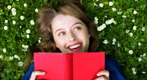 A woman excited to read a book