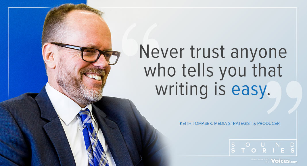 """Keith Tomasek is pictured infront of his quote, which says """"Never trust anyone who tells you that writing is easy."""""""