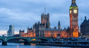 A photo shows the Palace of Westminster (in the UK) at dusk