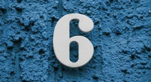 A large number six sits in the middle of a textured blue background.