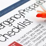 A side shot of an emergency prepared checklist. There is an orange highlighter set on the page.