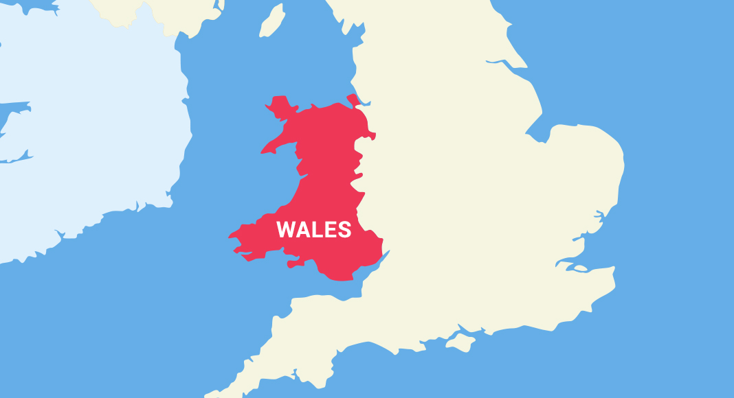 A map of the UK shows Wales highlighted in red