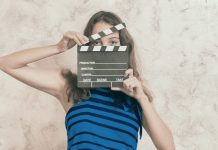 Illustration depicts woman with movie clapper in blue shirt