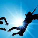 The silhouettes of two trapeze artists show one extending his hands to the other, who is in mid-air