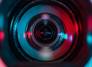A very close up shot of a camera lens, head on