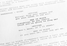 A close up of a script describes a scene between a police man and a robber