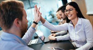 Happy business people giving a high five