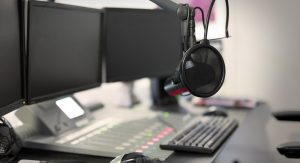 Radio station setup with microphone and pop filter