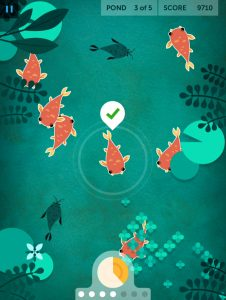 A screenshot of the Lumosity Game called Playing Koishows an illustrated pond full of fish, where one had just been fed.