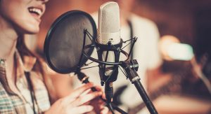 female voice talent, microphone, pop filter