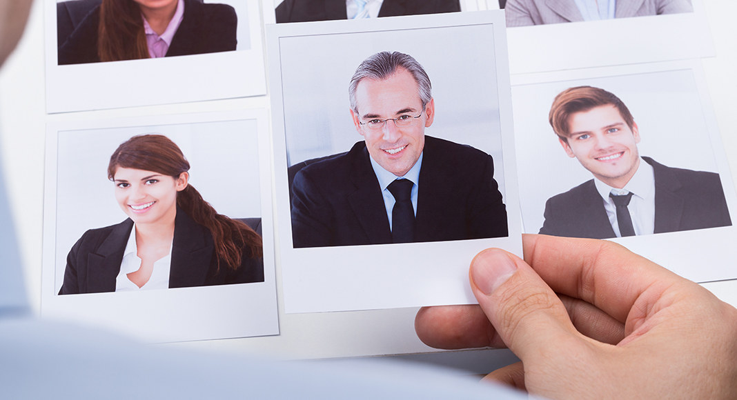 Several photos of business people with one selected