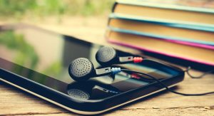 phone with headphones plugged in   Voices.com Blog - Where clients and voice actors can find valuable information on pre-production, technology, animation, video and audio production, home recording studios, business growth, voice acting and auditions, celebrity voice actors, voiceover industry news and more!