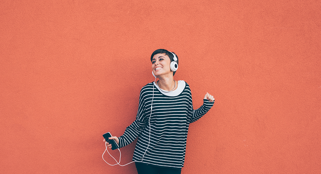 A woman very happy listening to music