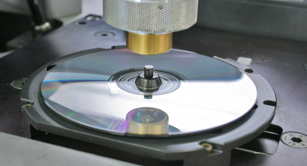 A compact disc being created