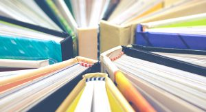 book spines array   Voices.com Blog - Where clients and voice actors can find valuable information on pre-production, technology, animation, video and audio production, home recording studios, business growth, voice acting and auditions, celebrity voice actors, voiceover industry news and more!
