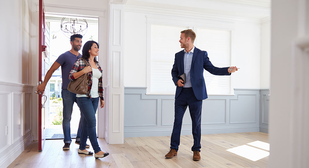 Realtor showing a couple a home