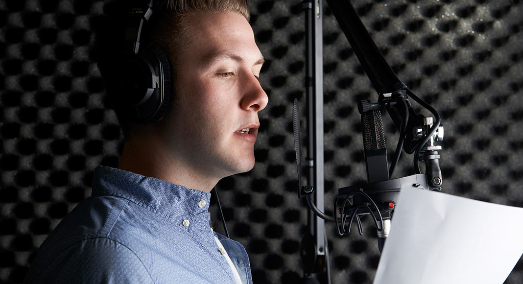 A man reading a voice over script