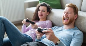 A millennial couple playing video games together