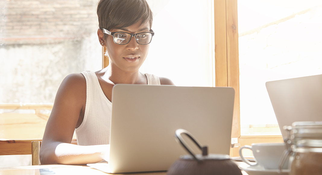 Woman working at computer to increase productivity