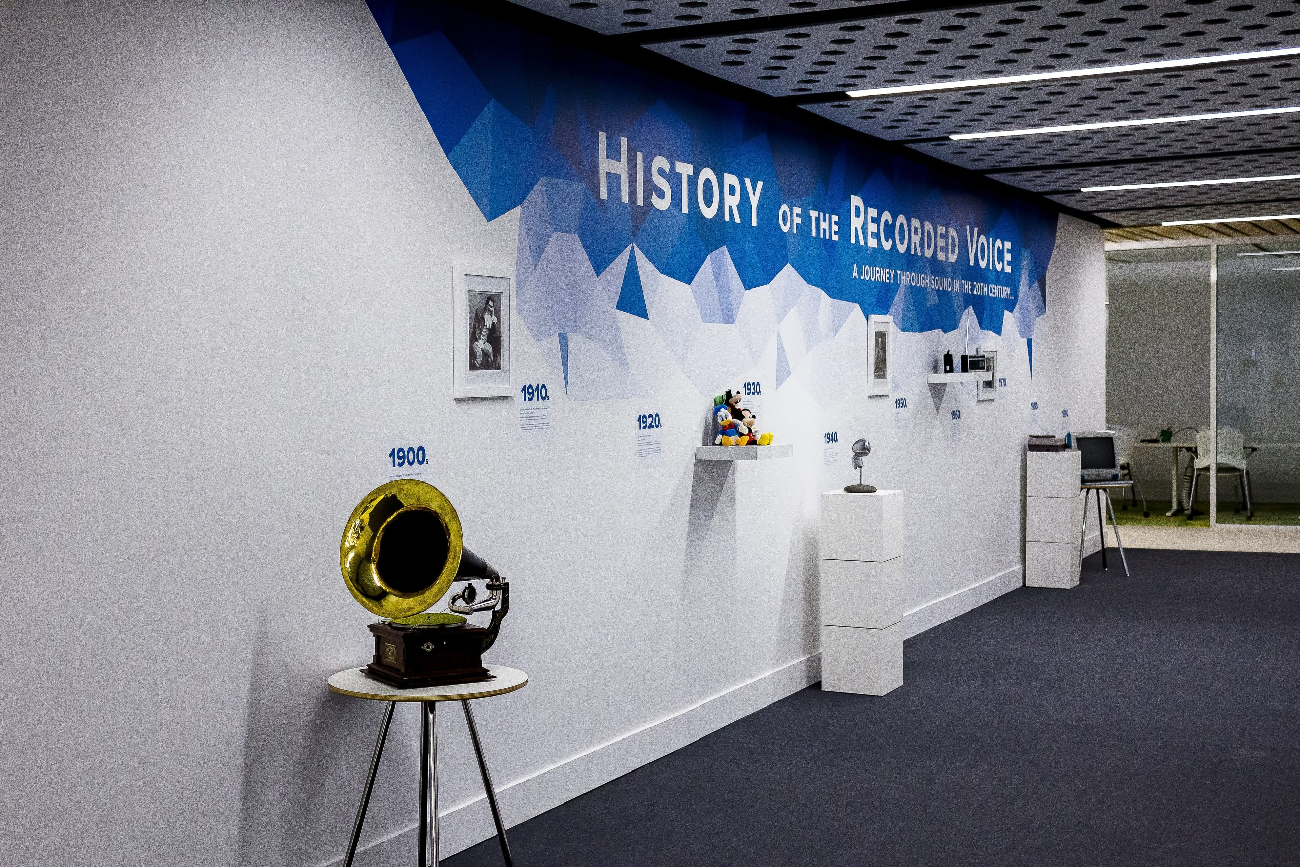 "The gallery hallway of the office, which has a display of the ""History of the Recorded Voice"" on the wall."