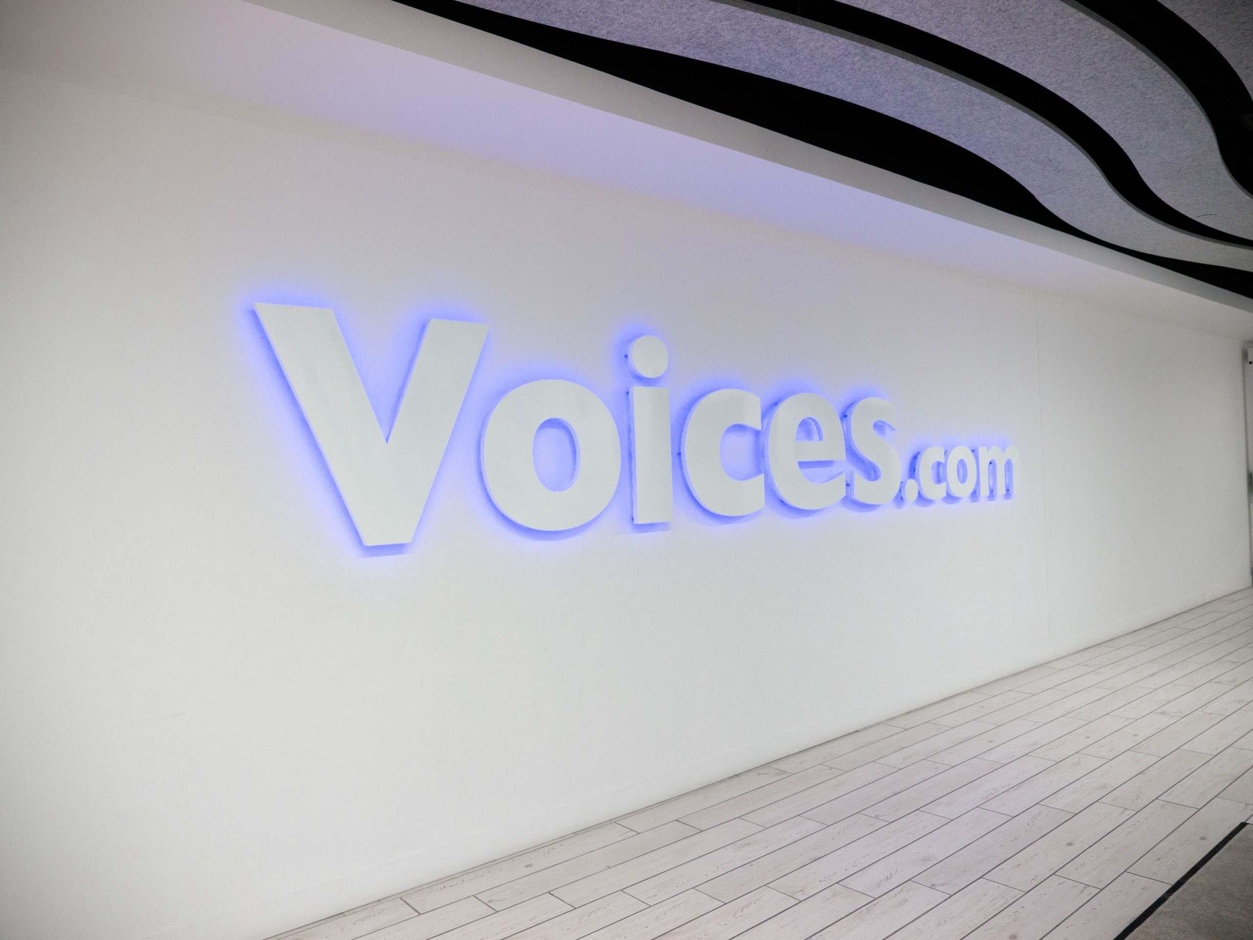 The Voices sign in the entrance of the Voices office.