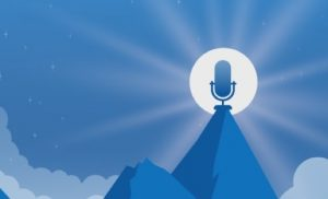 A microphone sitting on the top of a mountain at night, with the moon shining behind it.