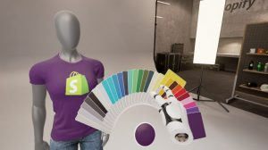 A photo from inside a VR program. The user is choosing from a collection of colour swatches, which are being displayed on a t-shirt that a mannequin is wearing.