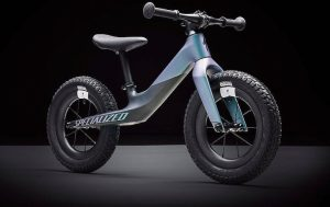 Aqua-blue and grey-coloured children's bicycle manufactured by Specialized Bicycles
