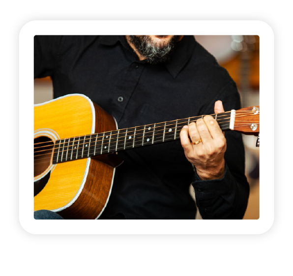 A musician playing on an acoustic guitar.
