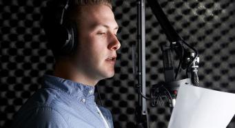 A man reading a voice over script.